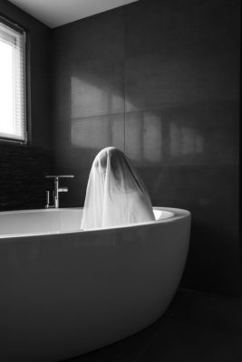 Woman in bathtub with voile